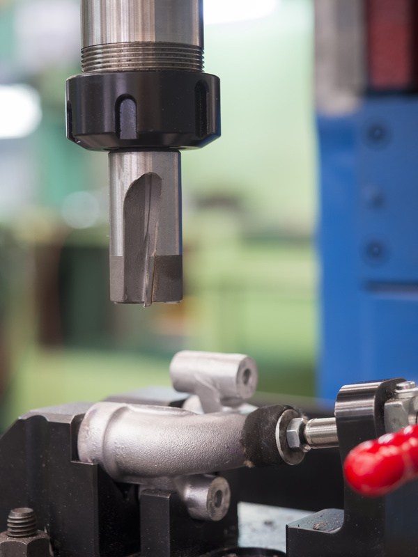 operator machining aluminum automotive parts by machining center